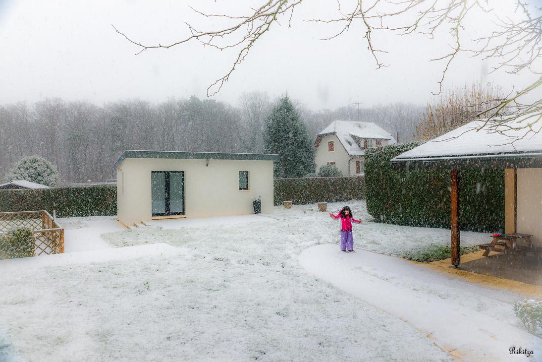 Enjoying snow by Rikitza