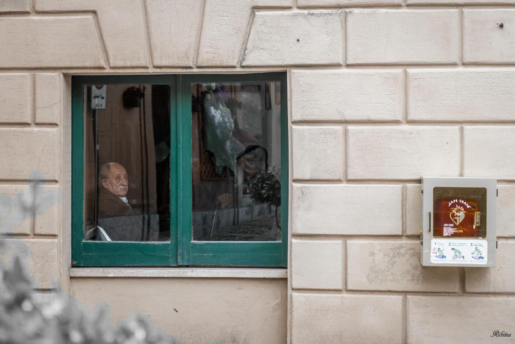 Man Looking Thru The Window by Rikitza