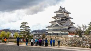 admiring architecture at the Matsumoto castle