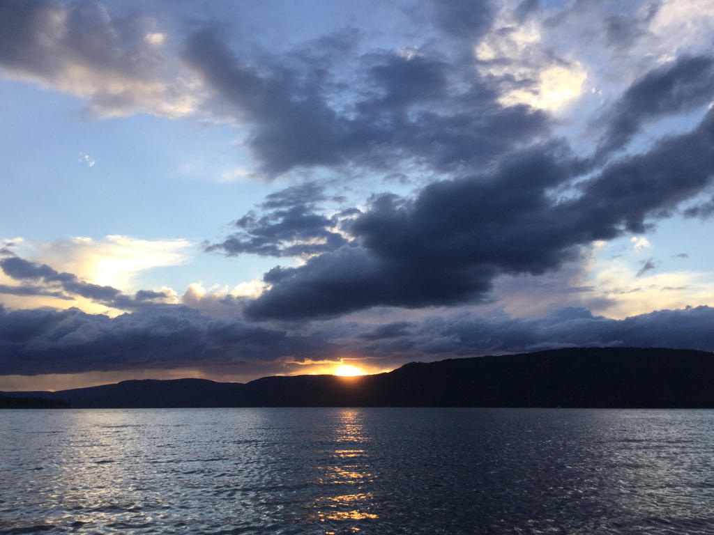 Sunsets on the Water 1: As the Clouds Role In by JoyJinn