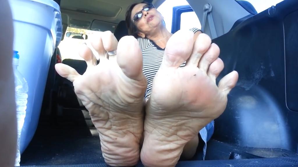 Mature feet tease