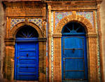 Side by Side Blue Doors in Morocco by shuckaby