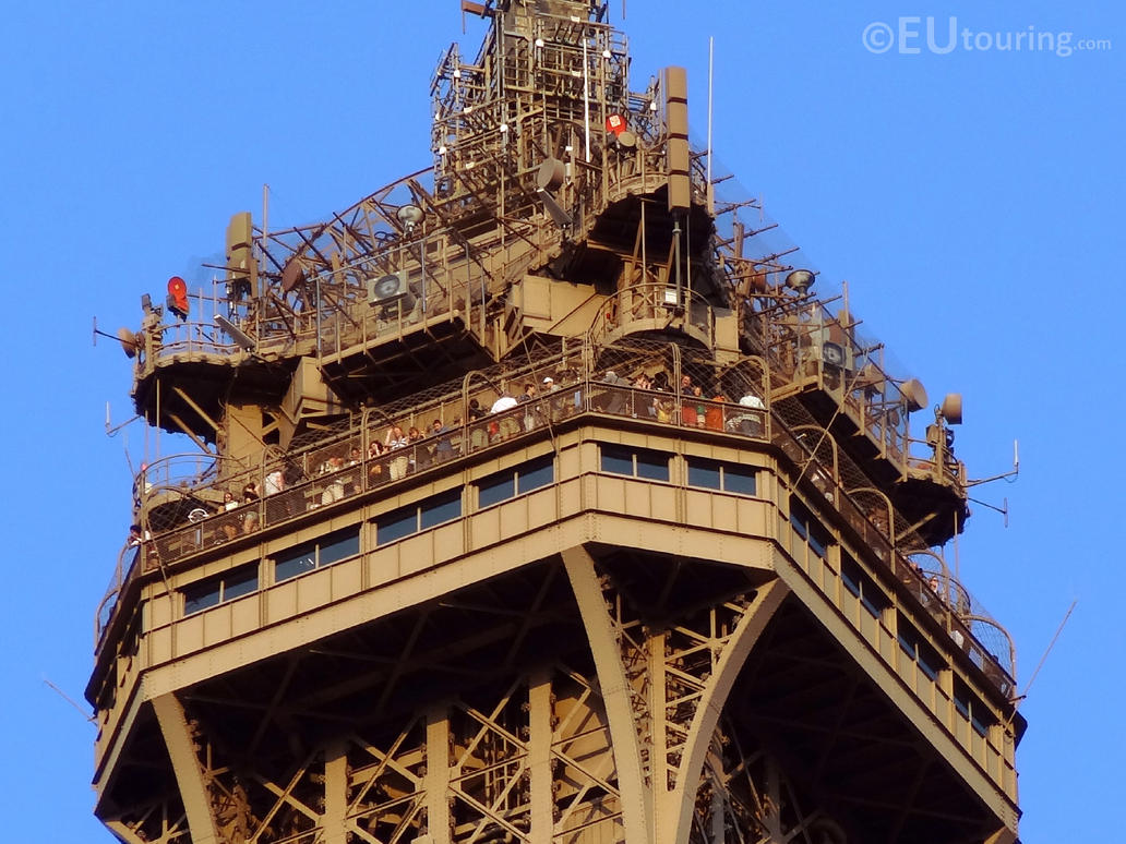 close up of the eiffel towers platform by eutouring on
