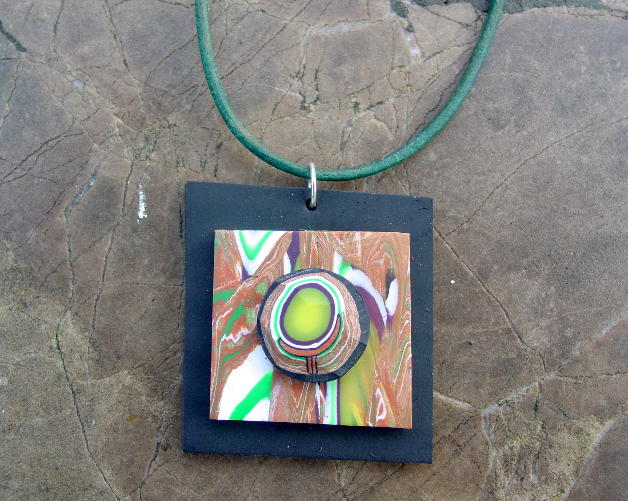 Held Circle Pendant by ezo