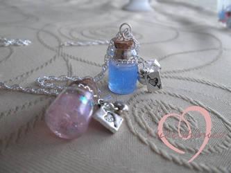 Alice inspired bottle pendants by ilikeshiniesfakery