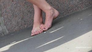 barefoot girl walks with dirty feet
