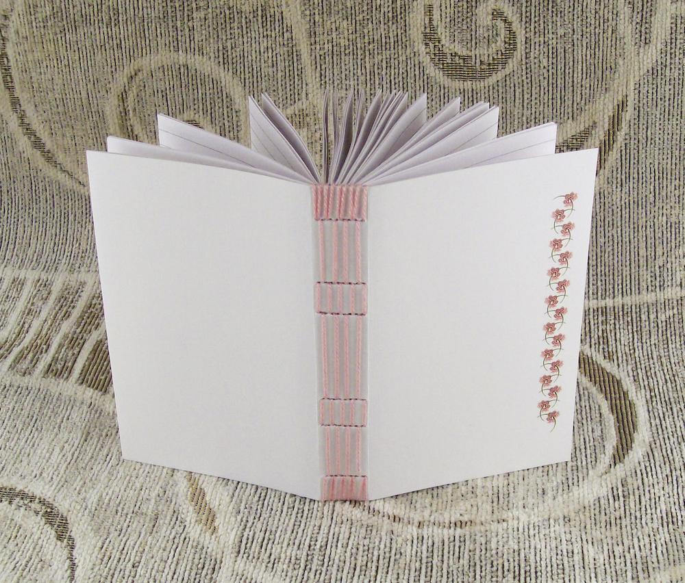 pink stitches, lined journal by yatsu