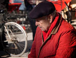 Red coat. Lucca. Italy