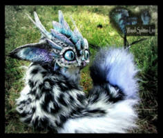 -SOLD- Posable Snow Leopard Dragon