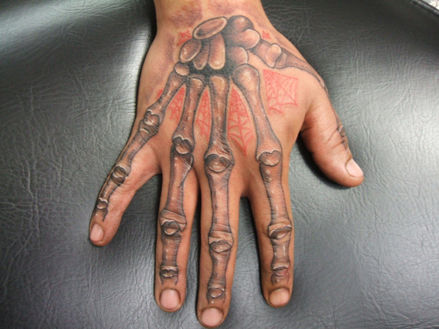 Skeleton hand tattoo by bodygraffixtattoo