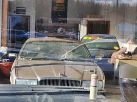 Abandoned Jaguar and VW Golf