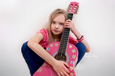 A girl and her guitar by Lady-Tori