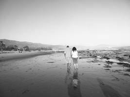 mom and dad on tha beach by graphicphotographer