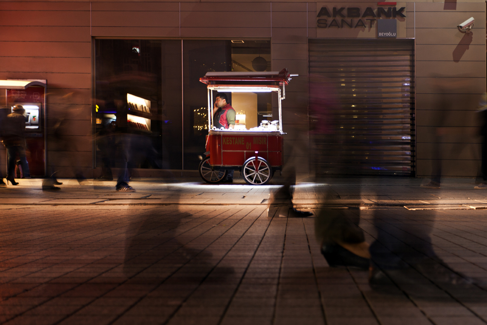 Chestnuts seller and the passersby. by Chris-Lamprianidis