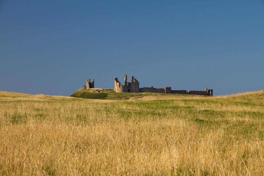 Distant Dunstanburgh by parallel-pam