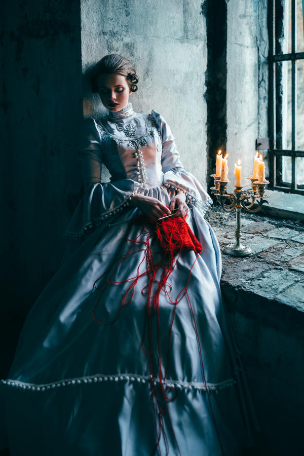 Woman In Victorian Dress Imprisoned In A Dungeon By Black