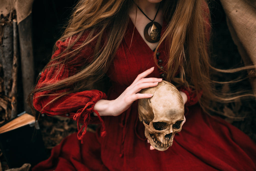 Witch holds the skull in hands by Black-Bl00d