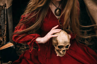 Witch holds the skull in hands