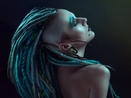 Pretty girl with dreadlocks posing in studio