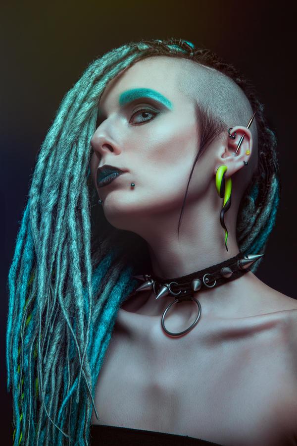 Pretty girl with dreadlocks posing in studio by Black ...
