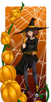 Witch among the pumpkins
