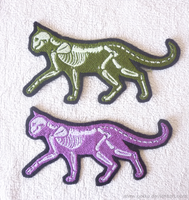 Green and purple X-ray cat GLOW patches by CyanFox3