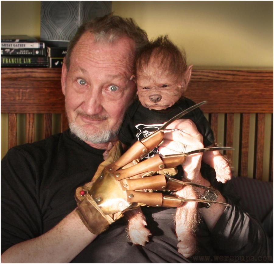 Robert Englund cuddles Ezra the WerePup by WerePups
