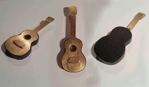 Brass 4 string mini guitar