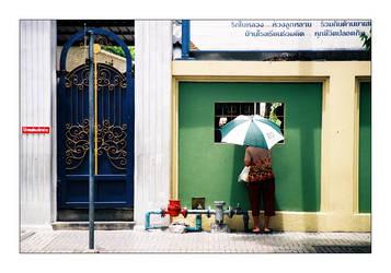 Woman with umbrella by dekleene