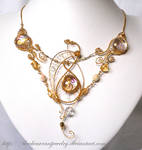 Golden butterfly by blackcurrantjewelry