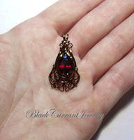 Garnet and Bronze Wire Pendant by blackcurrantjewelry