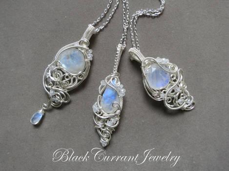 Three Rainbow Moonstone and Silver Pendants