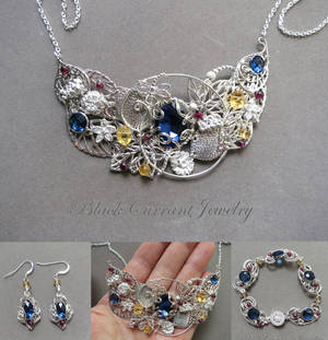 Jewelry set with blue, yellow and red stones