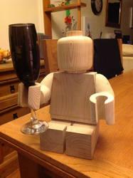 Wooden lego man 'cheers' by Ragskin