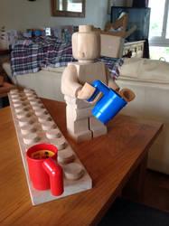 Wooden lego man drinking tea by Ragskin