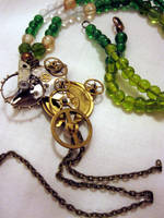 Green antiques necklace by Gothic-Enchantress