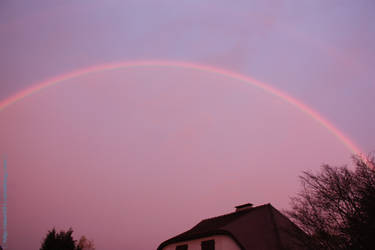 Rainbow in a purple sky