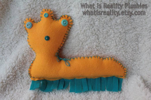 Wiggly felt monster plush