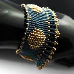 Blue and golden bead loomed bracelet with fringe