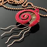 Wire woven ammonite pendant