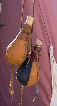 Small leather covered bottles
