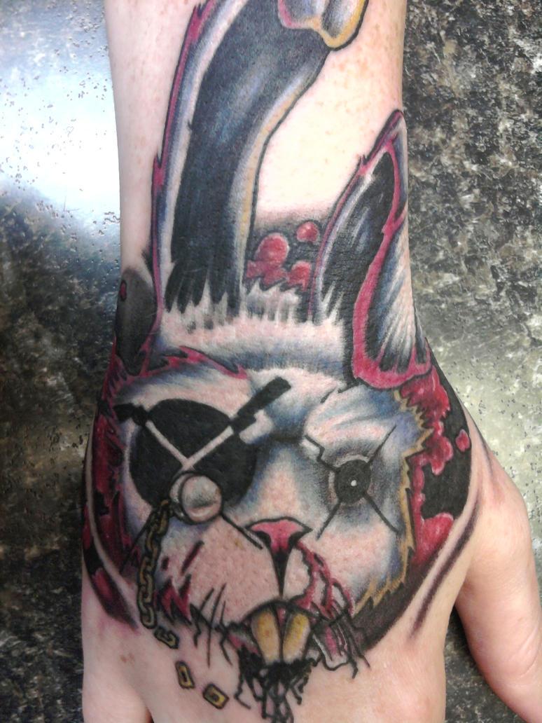 white rabbit hand tattoo by