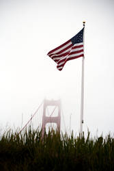 U.S. Flag over the Golden Gate Bridge by richardxthripp