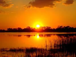 Fiery Orange Sunset by richardxthripp
