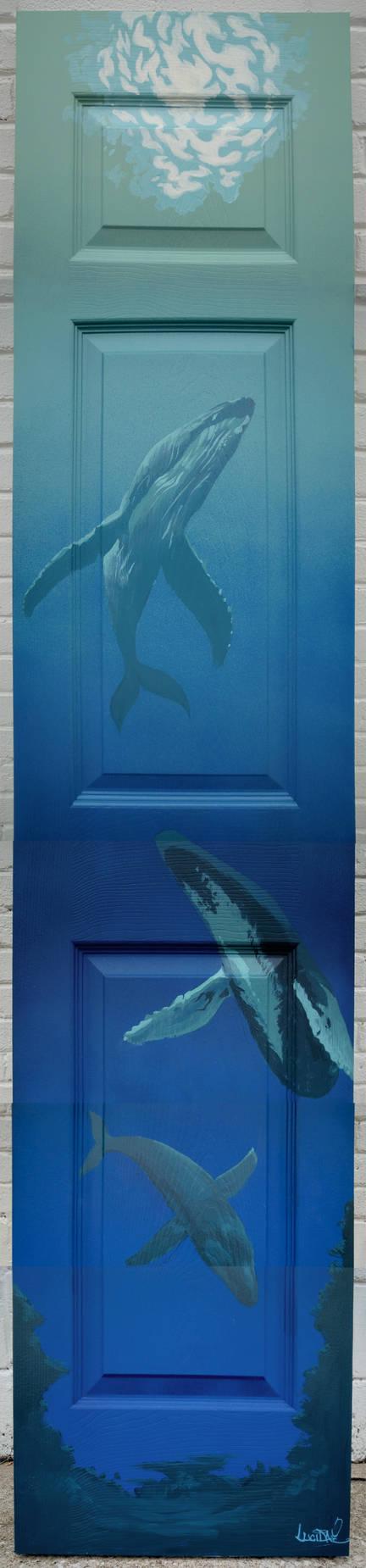 humpback whales on door panel