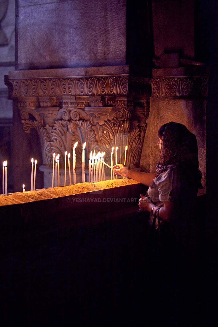 Lighting candles at Church of the Holy Sepulchre by yeshayad