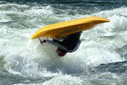 Yellow kayak in mid-air
