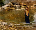 Wading By A Waterfall