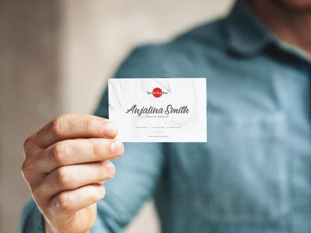 Free man holding in hand business card mockup psd by freebiedesign colourmoves