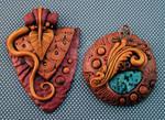 Bronze and Gold Pendants